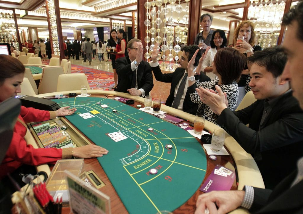 people playing baccarat in casino