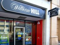 William Hill Blasted for Trying to Squeeze Money from FOBTs Players as MPs Delay Clampdown