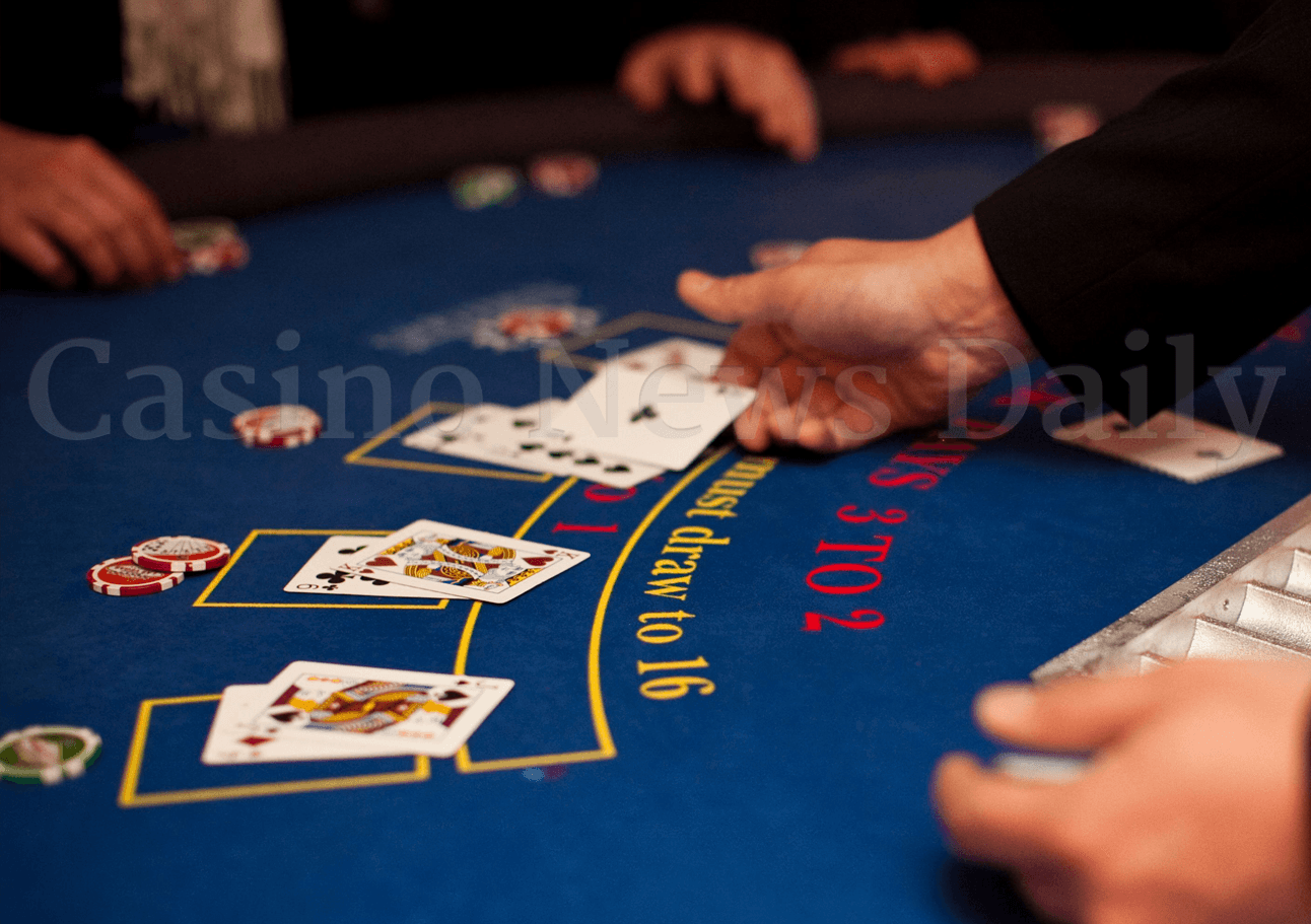 Blackjack dealer dealing cards.
