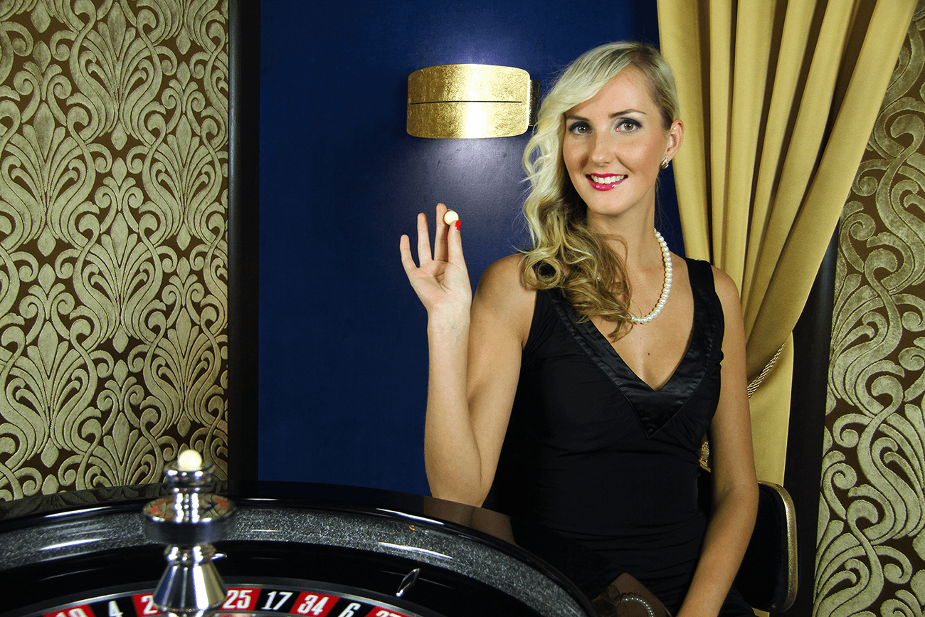 Roulette dealer showing roulette ball