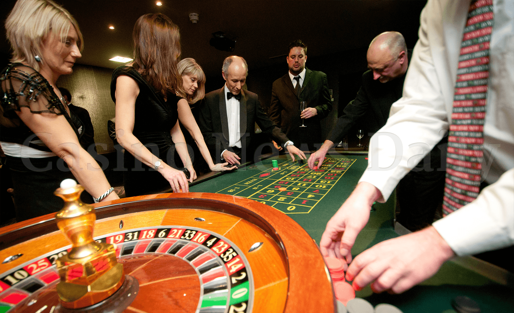 People around casino roulette table