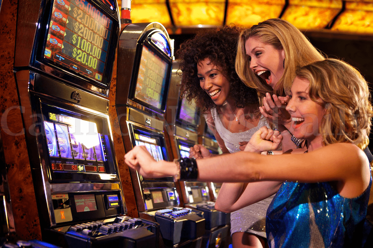 Photo of girls playing slots